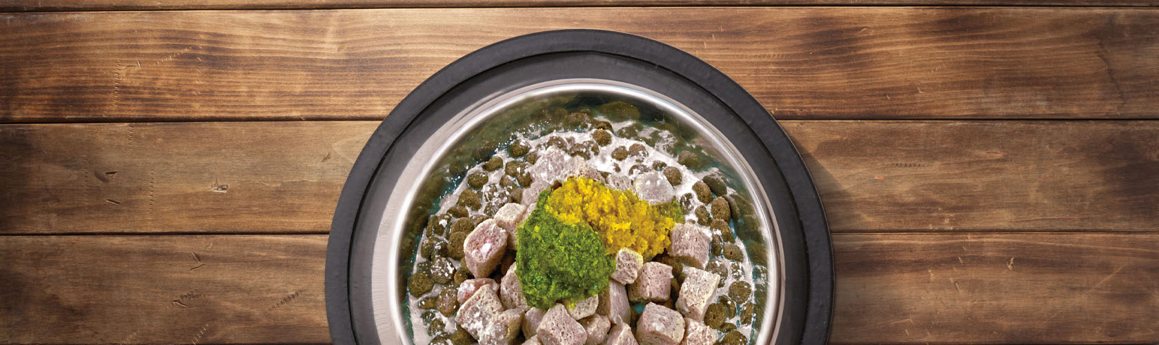 Wet and dry pet food in a bowl on wooden floor